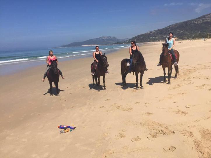 Paseo a caballo por la playa de los lances en tarifa.jpg